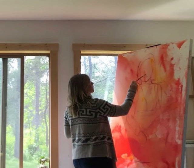 Sarah Brokke painting in her studio on the North Shore of Lake Superior.